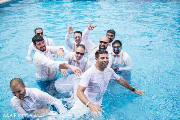 Funny capture of groom and groomsmen in the pool