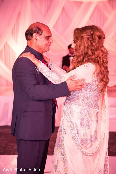 Sweet indian bride dancing with her father