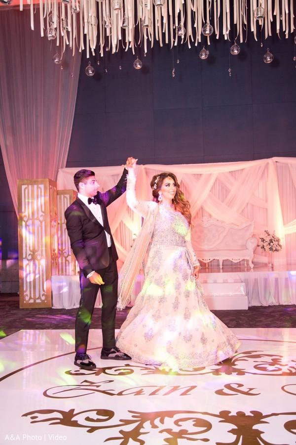 Dazzling Indian bride on the dance floor.