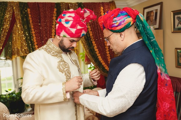 See this Indian groom putting his sherwani on.