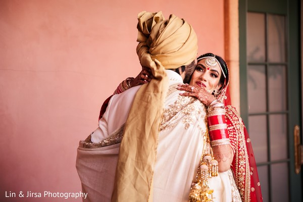 Indian bride and groom greeting each other
