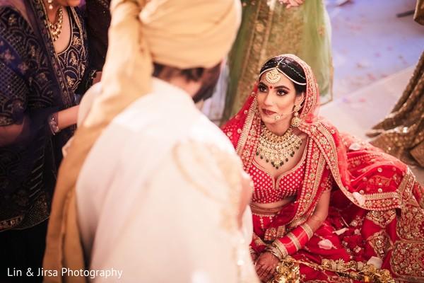 Maharani looking at Raja during the rituals