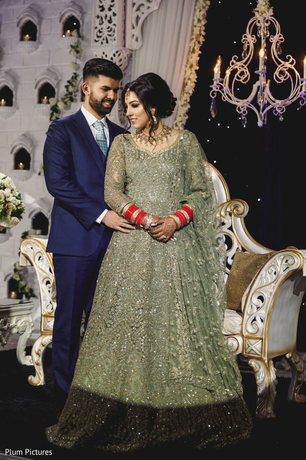 Lovely Indian couple posing on their reception outfits.