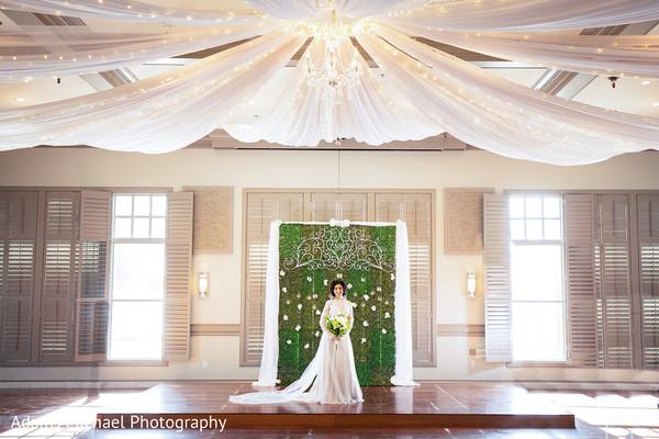Elegant indian bride and spectacular venue decoration