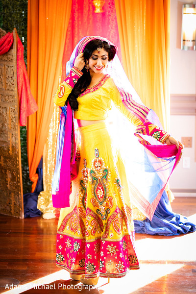 Magnificent Indian bride wearing a colorful dress.