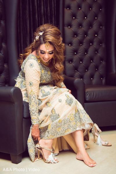 Ravishing indian bride showing her wonderful shoes.