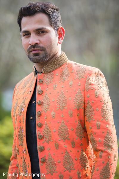 Joyful Indian groom on his sangeet sherwani.