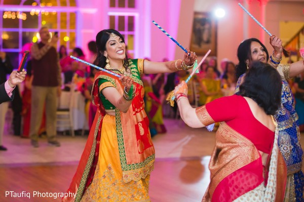 Dazzling indian bride at sangeet dance.