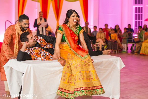 Joyful Indian bride at her sangeet celebration.