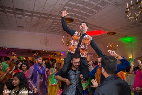 Indian groom having fun at Sangeet.