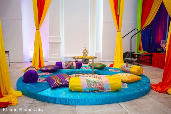 Colorful indian Sangeet seats decor.