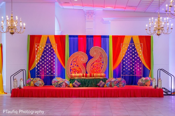 Colorful Indian pre- wedding stage decor.