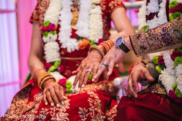 Indian couple showing their wedding rings.