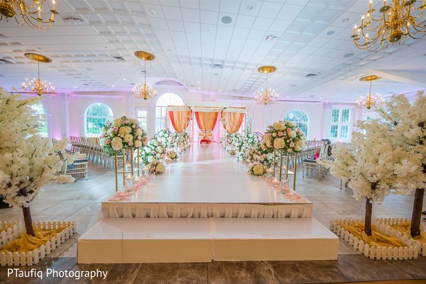Impressive Indian wedding ceremony aisle decor.