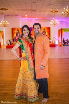 Marvelous Indian couple posing at sangeet photo shoot.