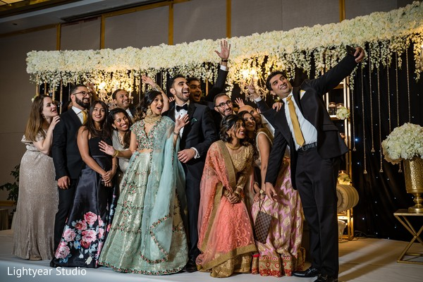 Indian wedding party selfie capture.