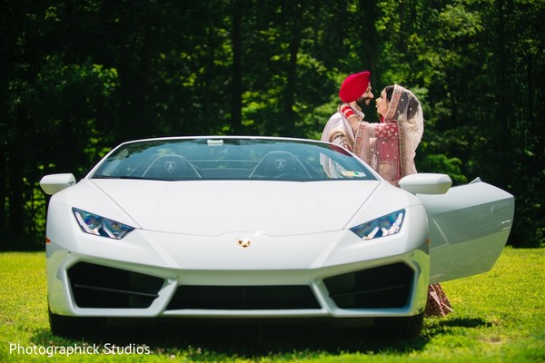 Indian bride and indian groom about to ride with elegance.