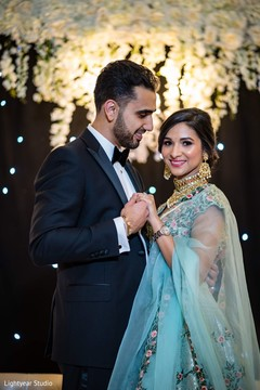 Incredible Indian couple on their reception outfits.