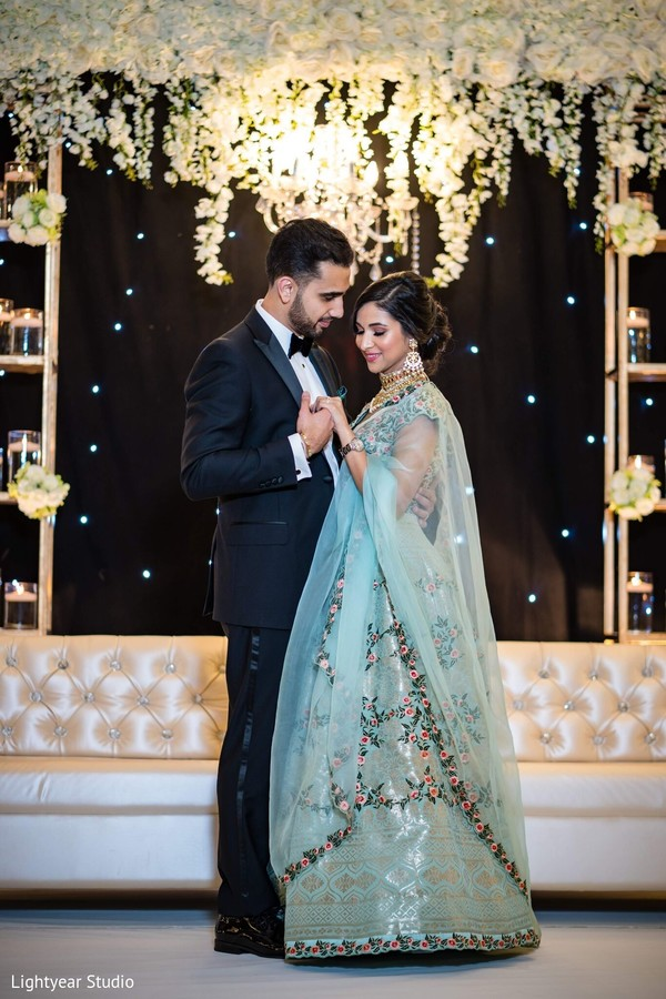 Romantic capture of Indian couple at reception dance.