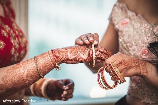 Indian bide getting her bangles on.