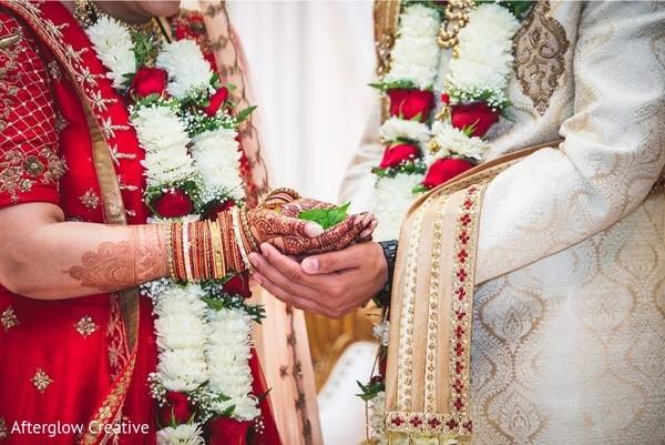Closeup capture of Indian couples hands at wedding rituals.