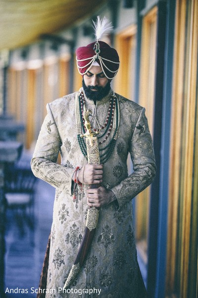Indian groom holding the kirpan.
