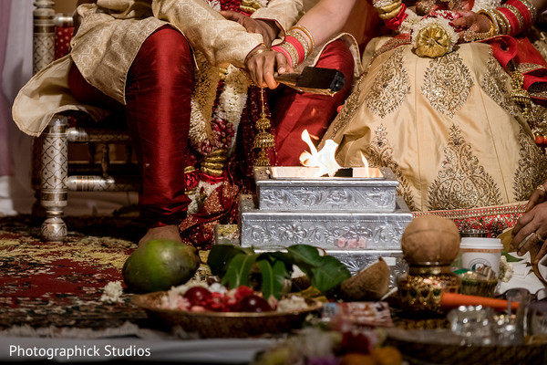 Indian couple making offerings to sacred fire