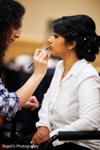 Our Maharani is getting her make up done.