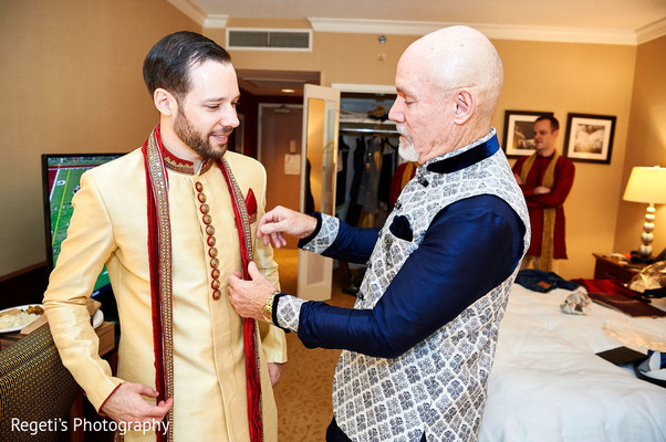 Final touches by groom's father.