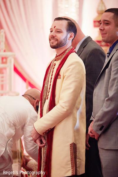 Joyful Indian groom at the ceremony.