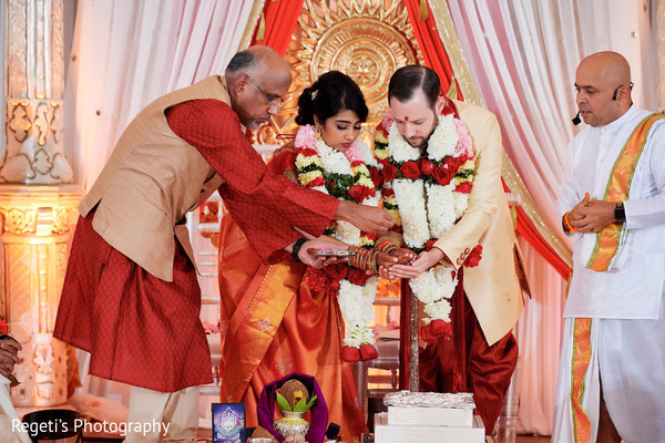 Indian bride and Indian groom receiving blessings.