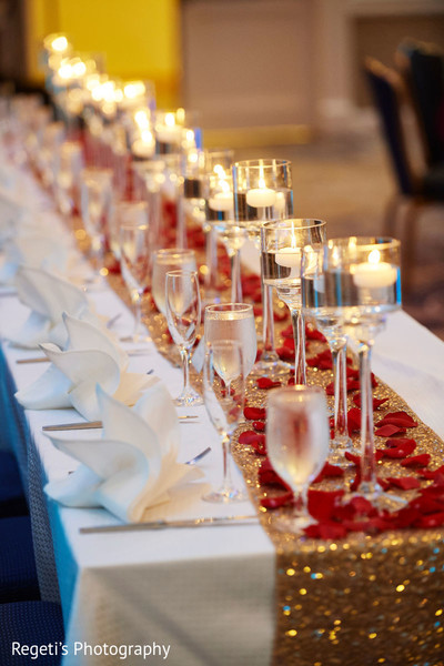 Elegant table decoration with candles and rose petals.