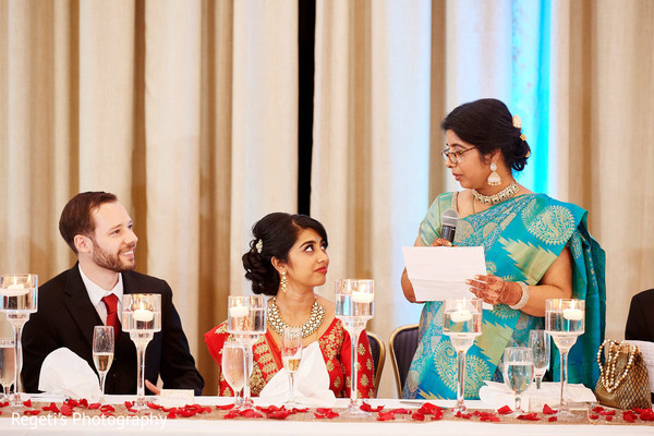 Our lovely Indian couple paying close attention to mother's words.
