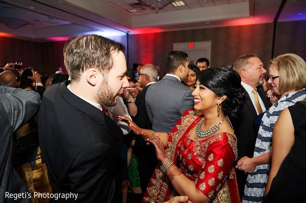 Indian couple having fun dancing.