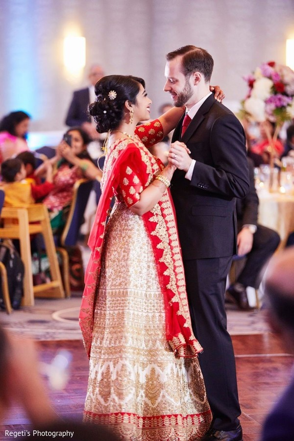 Such a romantic moment by or Indian couple on the dance floor.