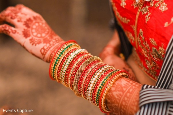 Lovely Indian bride wearing her chooras.