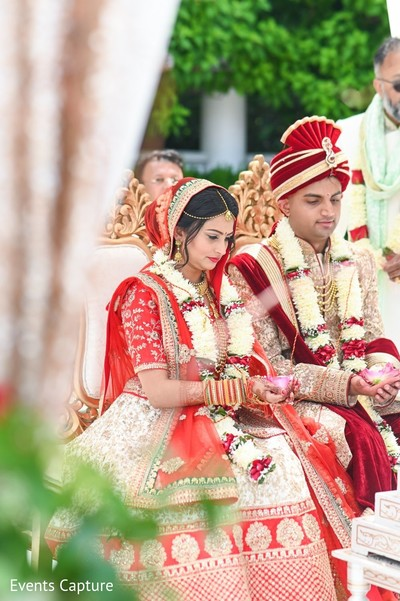 Indian couple holding the ritual petals.