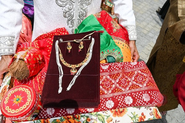 Indian wedding ceremony necklace and coconut.