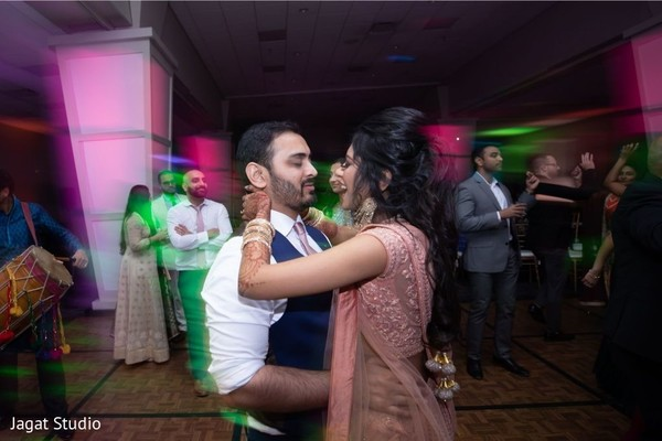 Take a look at this Indian couple on the dance floor.