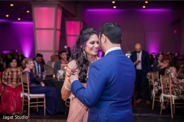 Lovely Indian couple dancing at the reception.