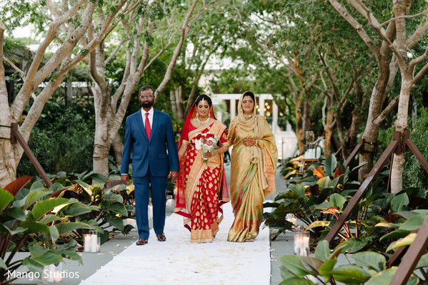 Charming Indian bride walking down the aisle.