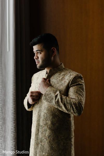 India groom getting ready.