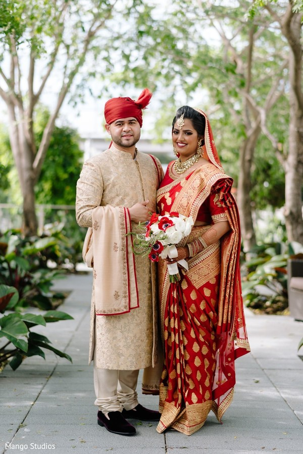 Lovely couple in their wedding ceremony outfit.