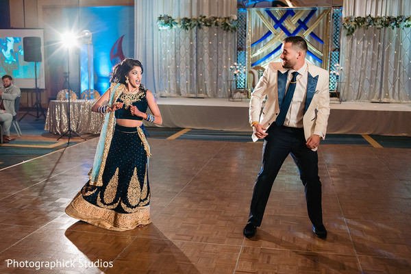 Charming Indian couple dance at the reception.