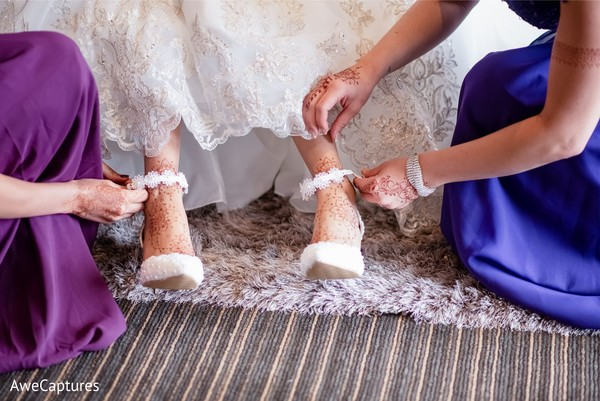 Indian bride getting her wedding shoes.