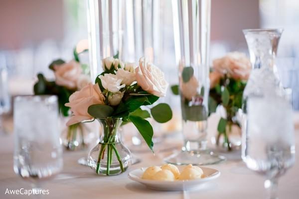 Incredible Indian wedding reception table  roses decor.