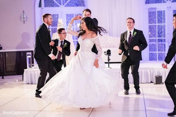 Indian bride, Indian groom with groomsmen dance.