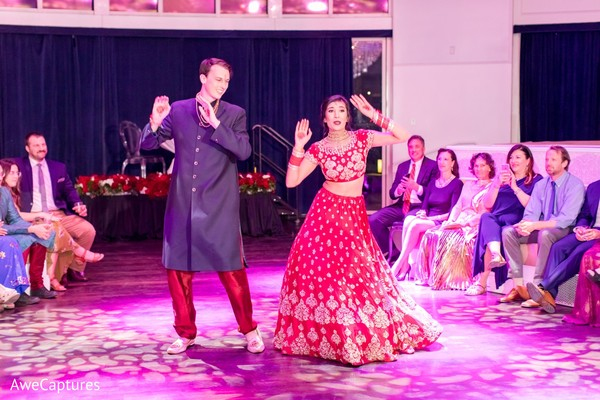 Indian bride and groom's dance performance.