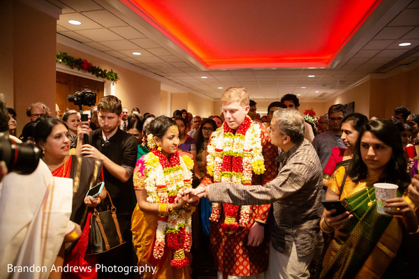 Indian bride saying goodbye to parents.