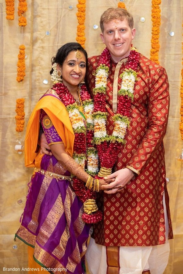 Indian couple posing with their wedding ceremony look.